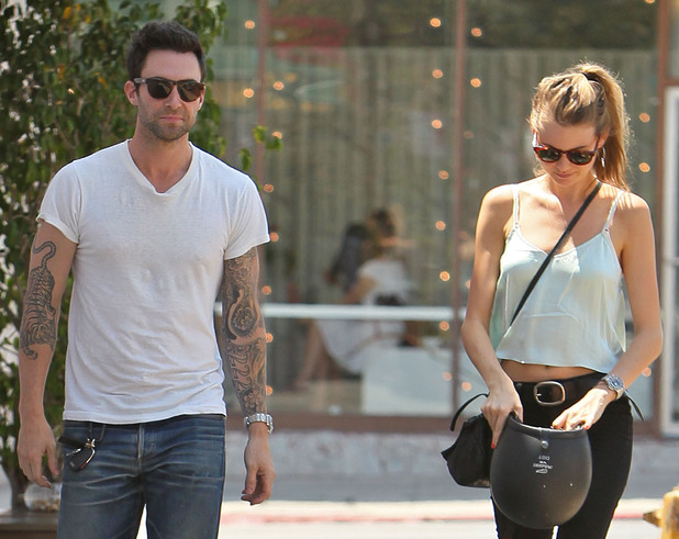 Adam Levine and girlfriend Behati Prinsloo returns to his parked motorcycle after having lunch at Mustard Seed Cafe in Los Feliz. Los Angeles, California