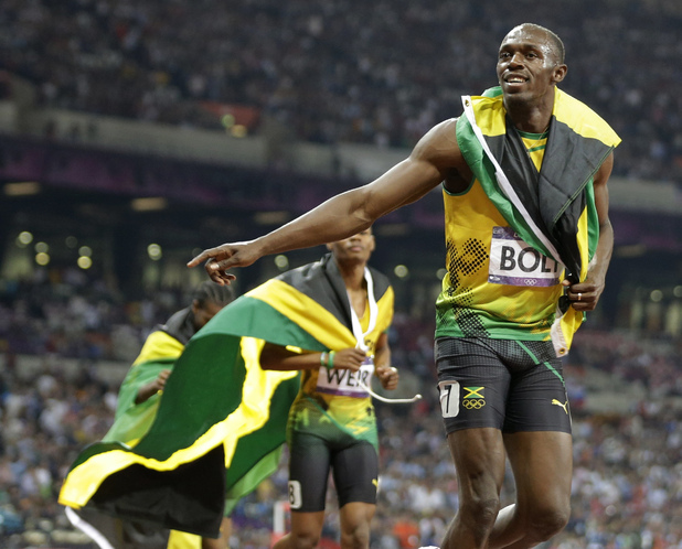 Usain Bolt celebrates men's 200m victory
