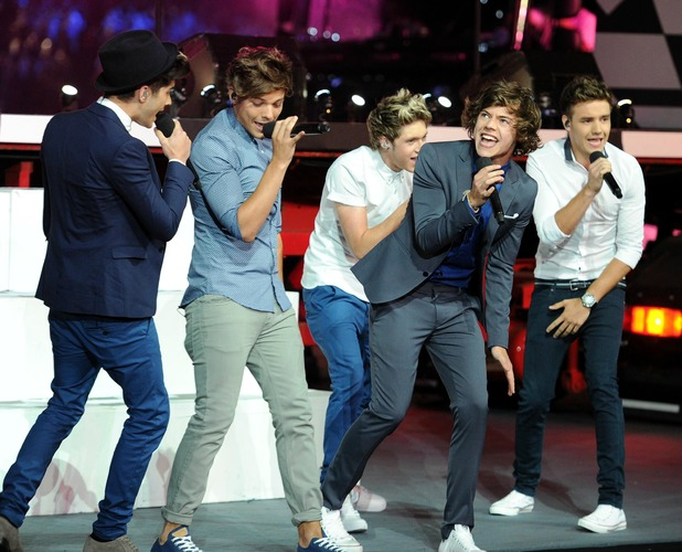 One Direction perform during the Olympic Games Closing Ceremony at the Olympic Stadium, London. Picture date: Sunday August 12, 2012. See PA story OLYMPICS Ceremony. Photo credit should read: Owen Humphreys/PA Wire. EDITORIAL USE ONLY