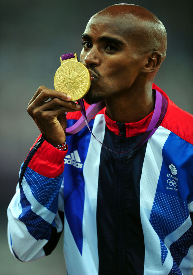 Mo Farah with his gold medal after winning the Men's 5,000 metres.