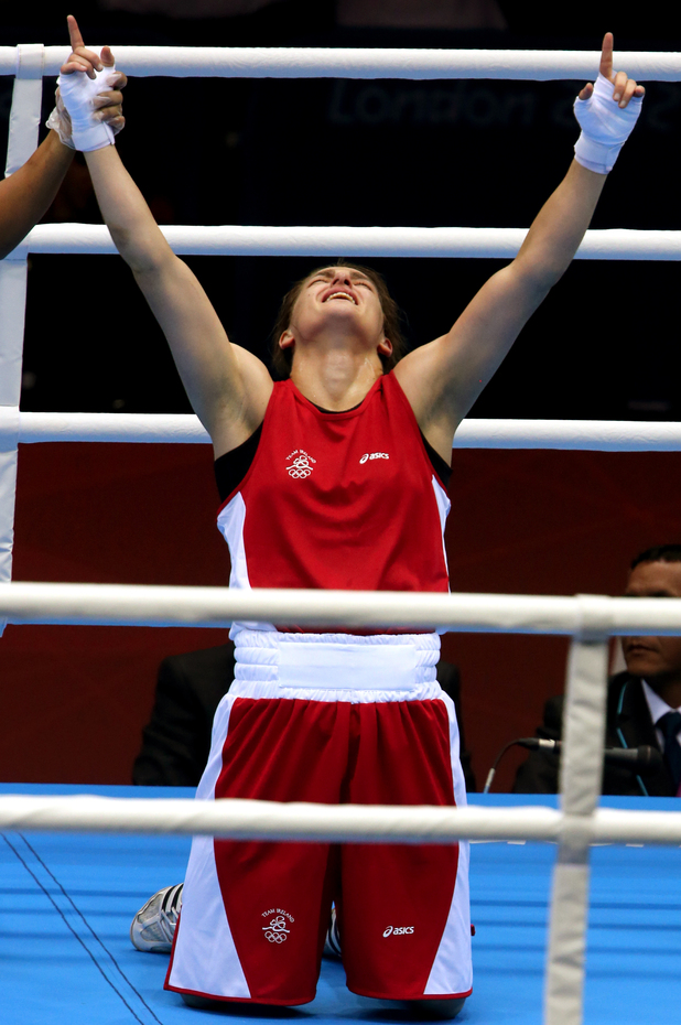 Katie Taylor celebrates a gold medal in the 60kg women's boxing category