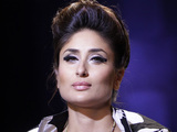 Bollywood actress Kareena Kapoor displays a creation by Kallol Datta at the grand finale during the Lakme Fashion Week in Mumbai, India