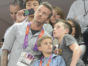 (L-R) David Beckham and his sons Romeo Beckham and Brooklyn Beckham, during the Men's Basketball gold medal game between the United States and Spain on Day 16 of the London 2012 Olympics Games at North Greenwich Arena London, England