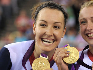 Dani King, Laura Trott and Joanna Rowsell celebrate after winning the Women's Team Pursuit Final