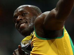 Jamaica&#39;s Usain Bolt celebrates winning the Men&#39;s 100m Final at the Olympic Stadium on day nine of the London 2012 Olympic Games.