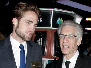 Robert Pattinson and David Cronenberg visit the New York Stock Exchange to ring the opening bell USA - 14.08.12 **Not available for publication in USA Magazines.  Available for publication in the rest of the world.** Mandatory Credit: WENN.com