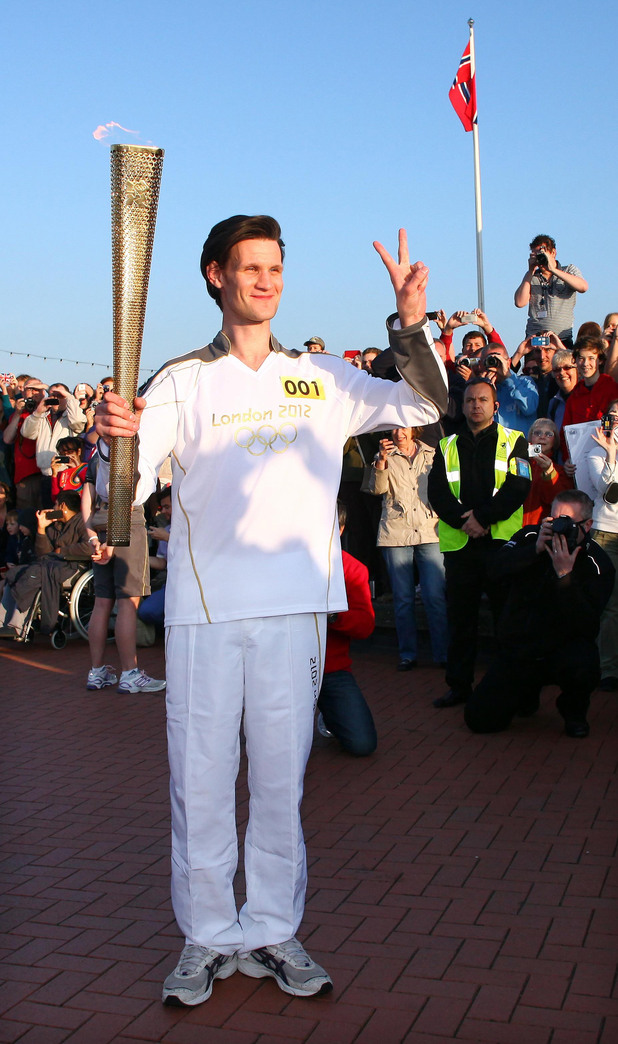 Matt Smith, carrying the Olympic Flame on the Torch Relay leg through Cardiff.
