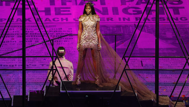 British model Naomi Campbell poses during the Closing Ceremony at the 2012 Summer Olympics, Sunday, Aug. 12, 2012, in London. (AP Photo/Alastair Grant)
