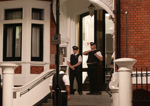 Police outside the Ecuadorian embassy on August 15, 2012. Julian Assange is thought to be staying here, as he seeks political asylum in Ecuador.