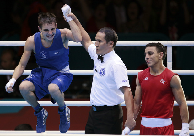 Michael Conlan of Ireland, left, and Nordine Oubaali of France, react after their men's quarterfinal flyweight 52-kg boxing match at the 2012 Summer Olympics, Tuesday, Aug. 7, 2012, in London. (AP Photo/Ivan Sekretarev)