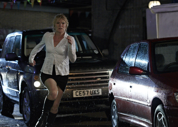 Shirley Carter rushes after Phil Mitchell in EastEnders