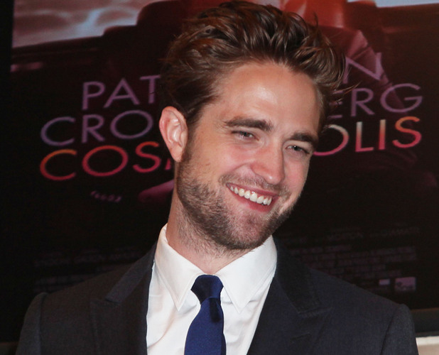 Robert Pattinson visits the New York Stock Exchange to ring the opening bell USA - 14.08.12 Mandatory Credit: PNP/WENN.com