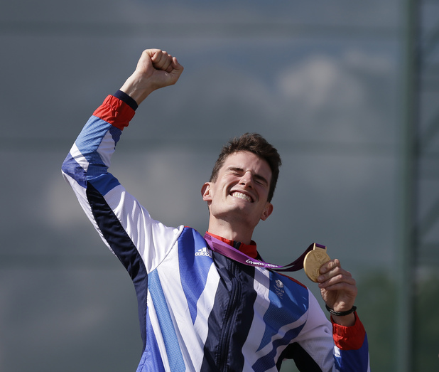 Great Britain's Peter Wilson reacts after receiving the gold medal for men's double trap event