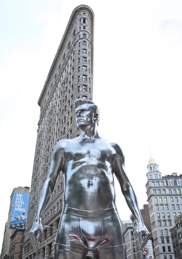 Atmosphere H&M promotes its new ad campaign for the 'David Beckham Bodywear collection' with a 10 foot statue of football star David Beckham at the Flatiron building, Manhattan. New York City, USA