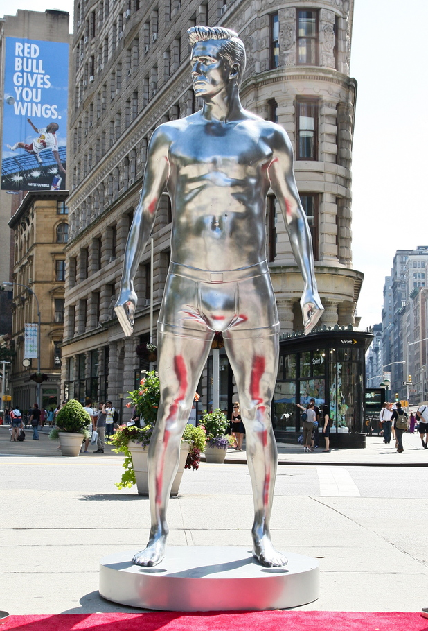 Atmosphere H&M promotes its new ad campaign for the 'David Beckham Bodywear collection' with a 10 foot statue of football star David Beckham at the Flatiron building, Manhattan. New York City,