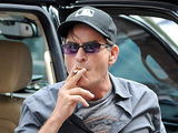 Charlie Sheen climbs out of his suv smoking a cigarette and heads back to his hotel in Toronto. Sheen made an appearance during the 3rd Annual Joe Carter Classic Golf Tournament. Toronto, Canada