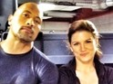 Johnson and Haywire star Gina Carano appear in the image.