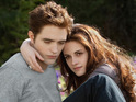 Edward and Bella embrace in new promotional stills from the Twilight.