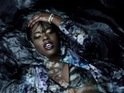 The rapper writhes around in water in her latest music video.