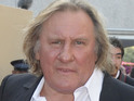 Gerard Depardieu receives Russian passport from Vladimir Putin.