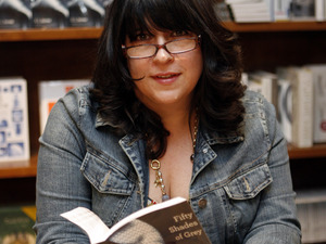Author E L James holds a copy of Fifty Shades of Grey