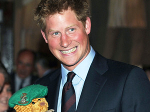 Prince Harry receives a forces bear at the Royal British Legion's 'Friends of the Forces' Awards in London London