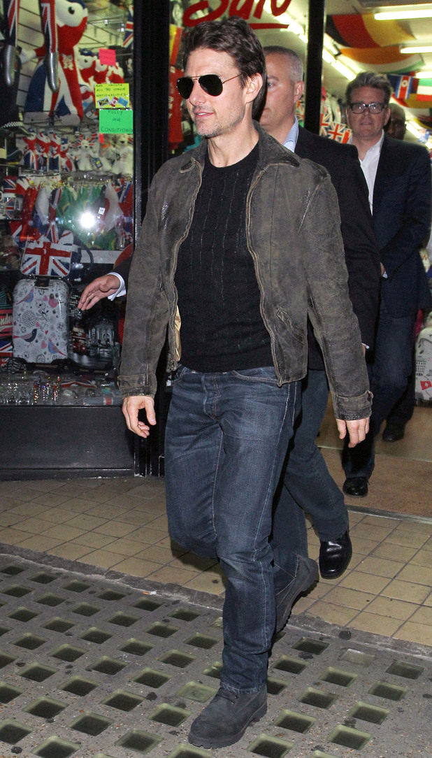 Tom Cruise leaves Chinawhite nightclub via a shop in busy Oxford Street after watching son Connor Cruise Djing.