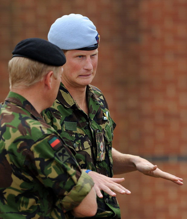 Prince Harry speaks with RAF personnel during a visit to RAF Honington in Suffolk