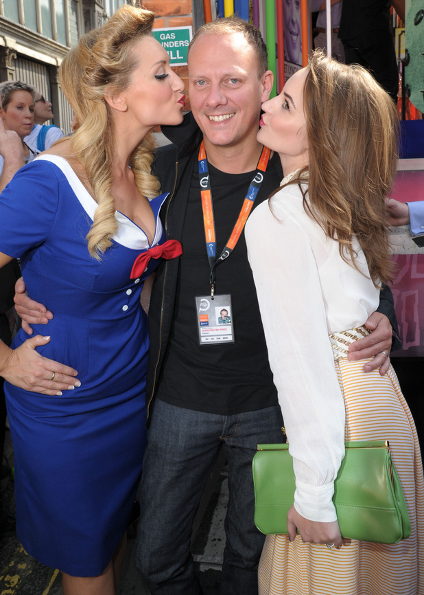 Catherine Tyldesley and Paula Lane plant kisses on Antony Cotton.