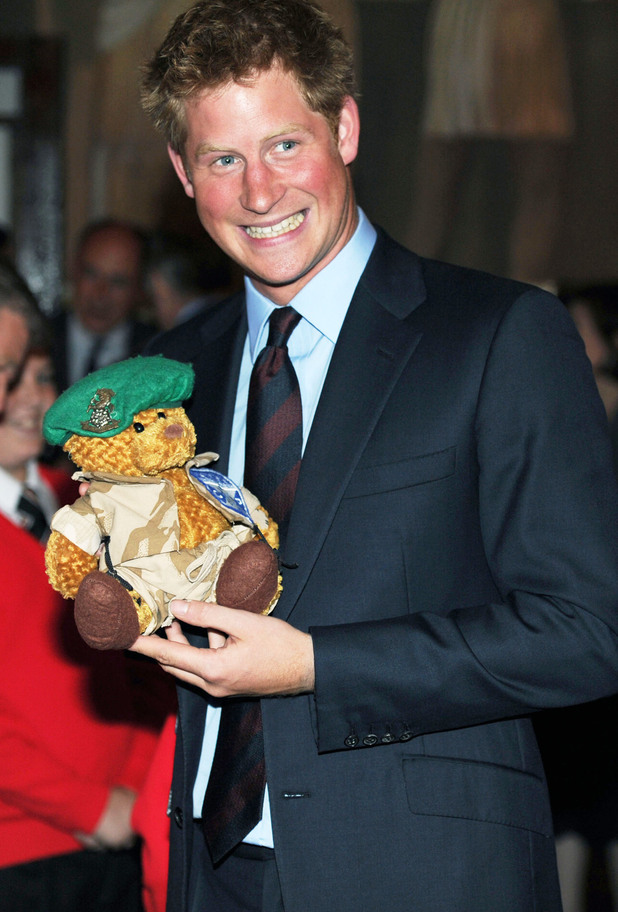 Prince Harry receives a forces bear at the Royal British Legion's 'Friends of the Forces' Awards in London 
