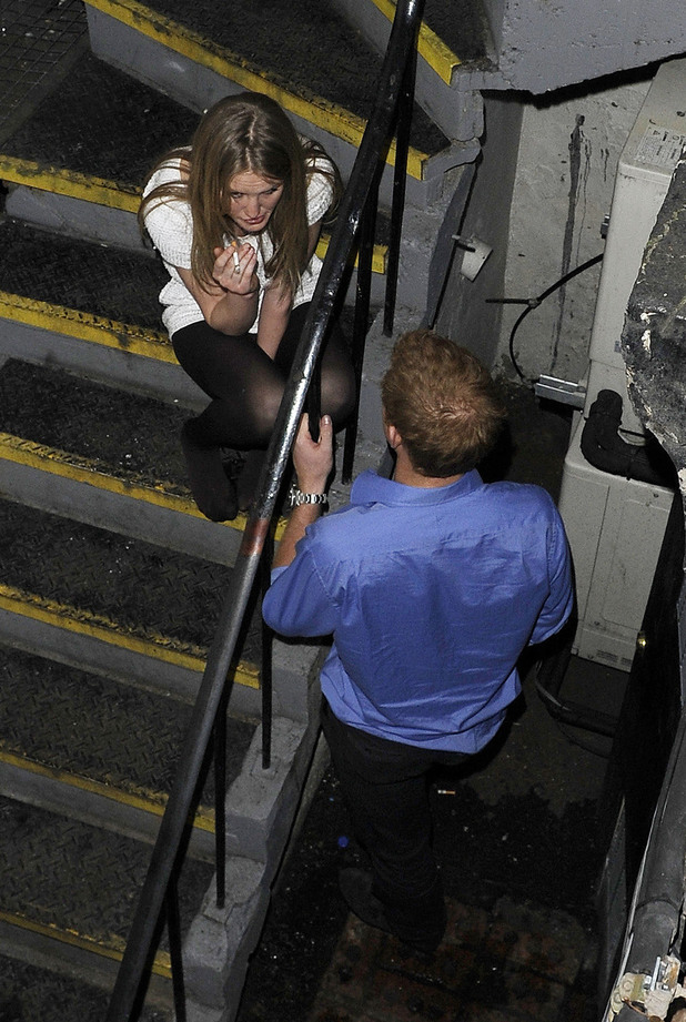 Prince Harry chats Lady Melissa Percy as she smokes a cigarette, outside the basement  entrance of The Brompton ClubLondon, England