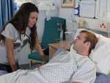Tina arrives at the hospital with Rita where they find a drugged up Tommy lying in bed with a broken leg
