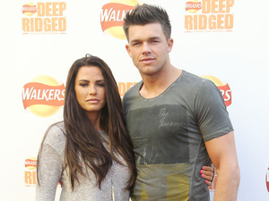 Katie Price and Leandro Penna Walker's deep ridged crisps - Britain's tallest climbing wall challenge - photocall, held at the Old Truman Brewery London, England - 29.08.12Mandatory Credit: Lia Toby/WENN.com