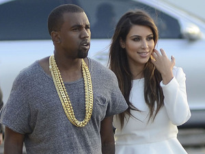 Kim Kardashian and Kanye West on their way to the Heliport in Manhattan.