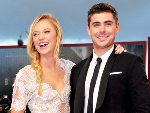Maika Monroe and Zac Efron on the red carpet of 'At Any Price'.
