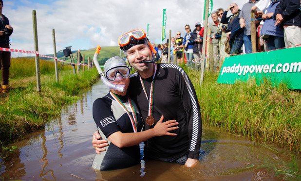 Simon Stratton from Cardiff making a wedding proposal to his girlfriend Elinor Robson during his taking part in this year's Bog Snorkelling Championships