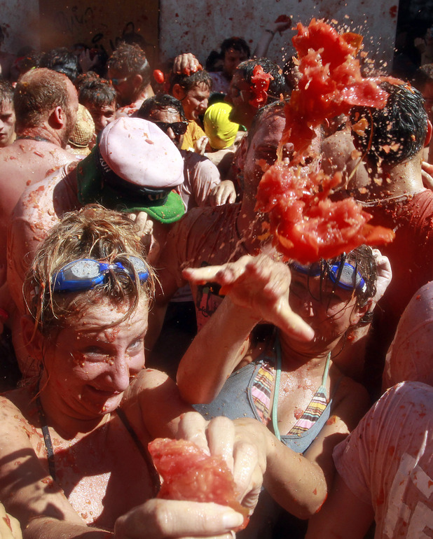 Revellers throw tomatoes at the annual La Tomatina festival in Bunol, Valencia, Spain (August 29, 2012)