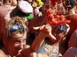 40,000 people attend annual La Tomatina food fight in Valencia.