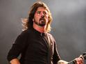 Dave Grohl from Foo Fighters playing Reading festival main stage.