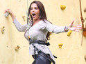 Katie Price and other stars climb Britain's tallest wall for Walkers Crisps.