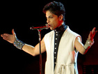 Prince signs landmark record deal with Warner Bros