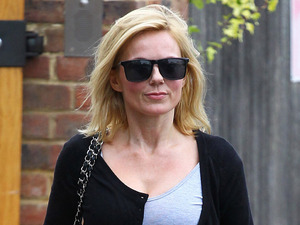 Geri Halliwell leaving home wearing a pink skirt and sunglasses London, England