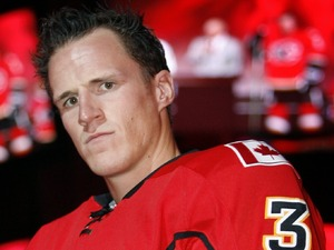 Calgary Flames defenseman Dion Phaneuf models the team&#39;s new uniform for the upcoming NHL hockey season in Calgary, Tuesday, Sept. 4, 2007.