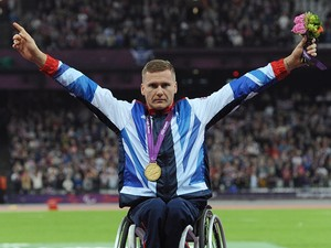Great Britain's David Weir celebrates with his gold after winning the Men's 800m - T54, during the Paralympic Games in London.