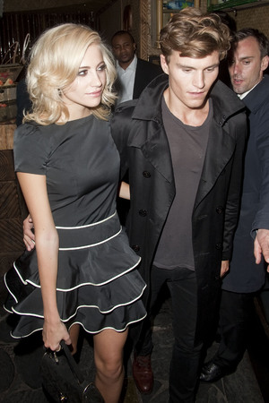 Pixie Lott and Oliver Cheshire leave an afterparty at Mahiki nightclub in London during 'Fashions Night Out' London, England