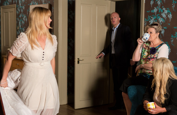 Max arrives to find Tanya on a wedding dress.