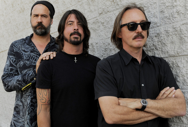"Krist Novoselic, left, and Dave Grohl, center, former members of the band Nirvana, pose with Butch Vig, producer of the band's landmark 1991 album ""Nevermind,"" poses in Los Angeles."