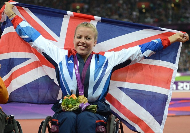 Great Britain's Hannah Cockroft celebrates with her Gold medal after winning the Women's 200m - T34