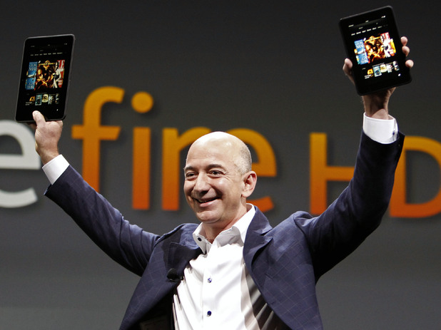 Jeff Bezos, CEO and founder of Amazon, holds the new at the introduction of the new Amazon Kindle Fire HD in Santa Monica, Calif., Thursday, Sept. 6, 2012.