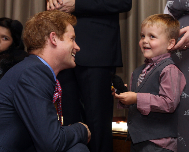 "Prince Harry talks to Alex Logan as he attends the WellChild awards ceremony InterContinental Park Lane Hotel, London. Picture date: Monday September 3, 2012. Alex, aged six, was interviewed by ITV News with his mother Debbie Logan ahead of the prize-giving event, and when asked what he would say to the royal replied: ""I'm glad you've got your clothes on Prince Harry"". See PA story ROYAL Harry. Photo credit should read: Lewis Whyld/PA Wire"